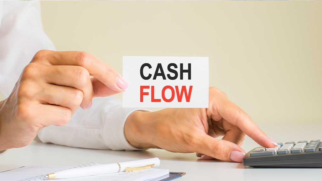 How can you ensure that hiring a property manager won't hurt your cash flow